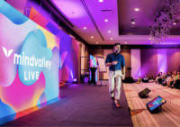 Vishen on stage at Mindvalley Live